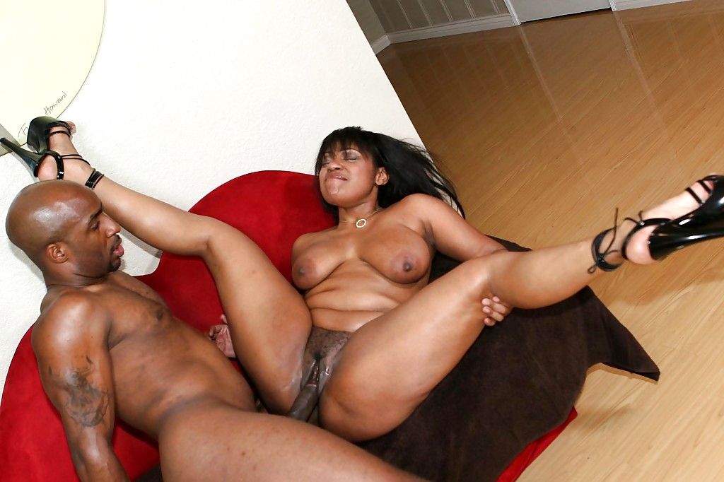 Horny black milf getting rocked by an ebony pecker