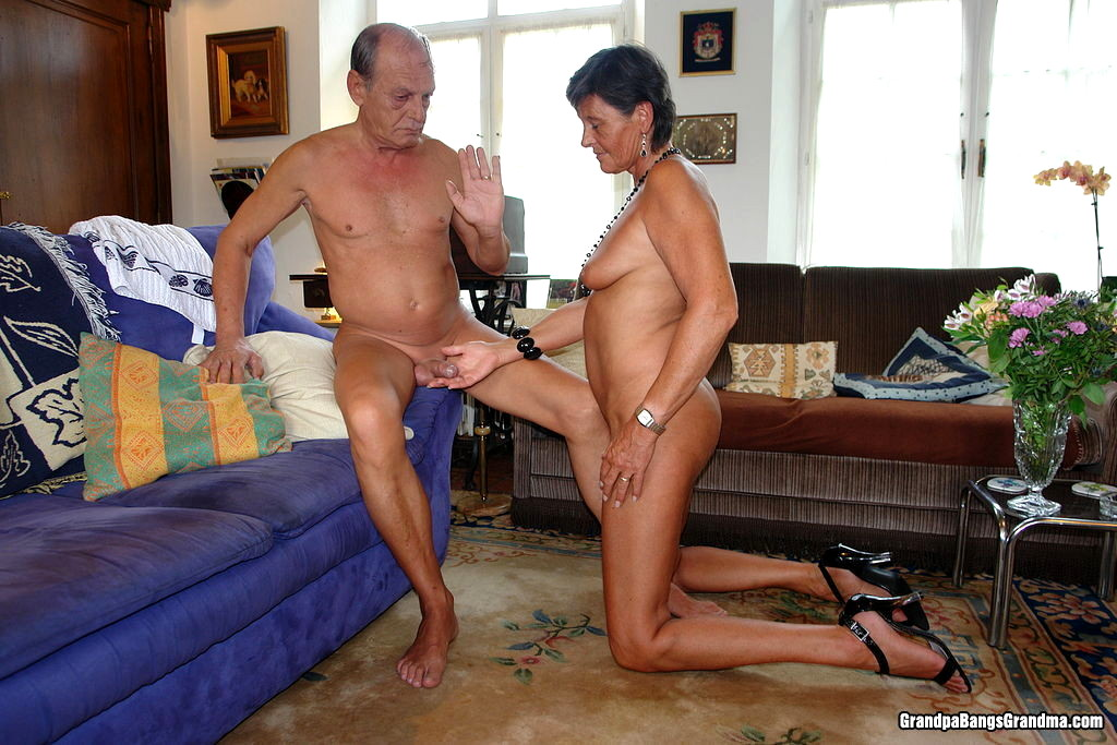 Mature couple jerking each other