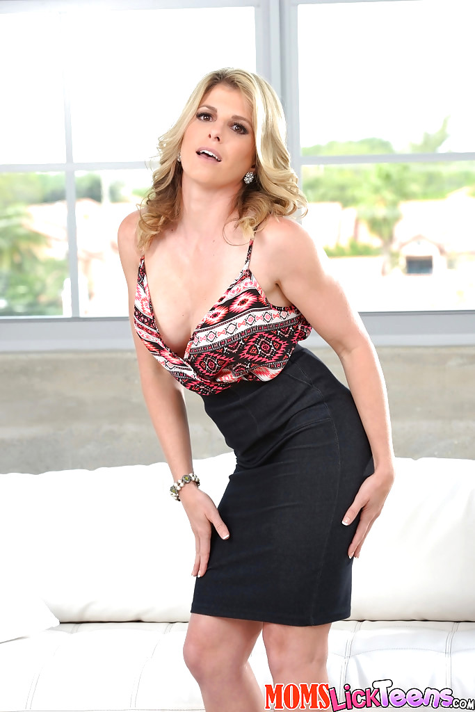 Solo MILF Cory Chase showing off large boobs in white stockings   417997
