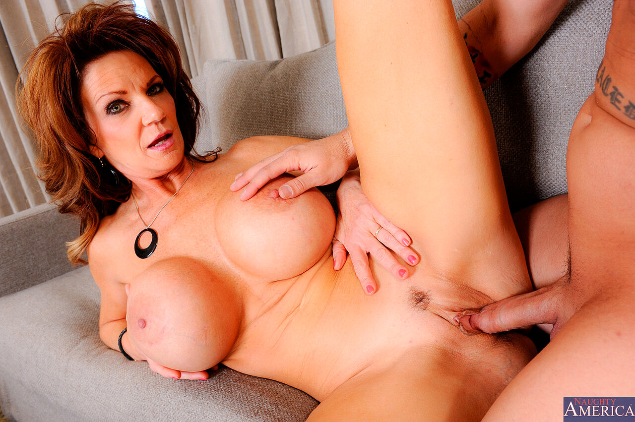 Busty cougar deauxma oils up exercises nude on her porch