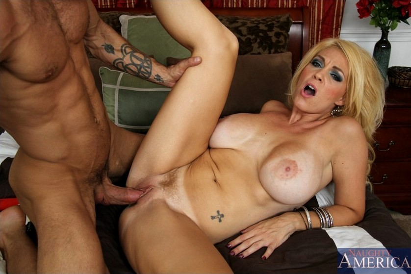Charlee Chase Rubs Her Tits On A Hard Cock And Blows It