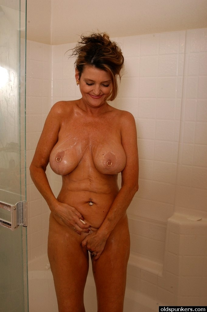 mature naked woman showers