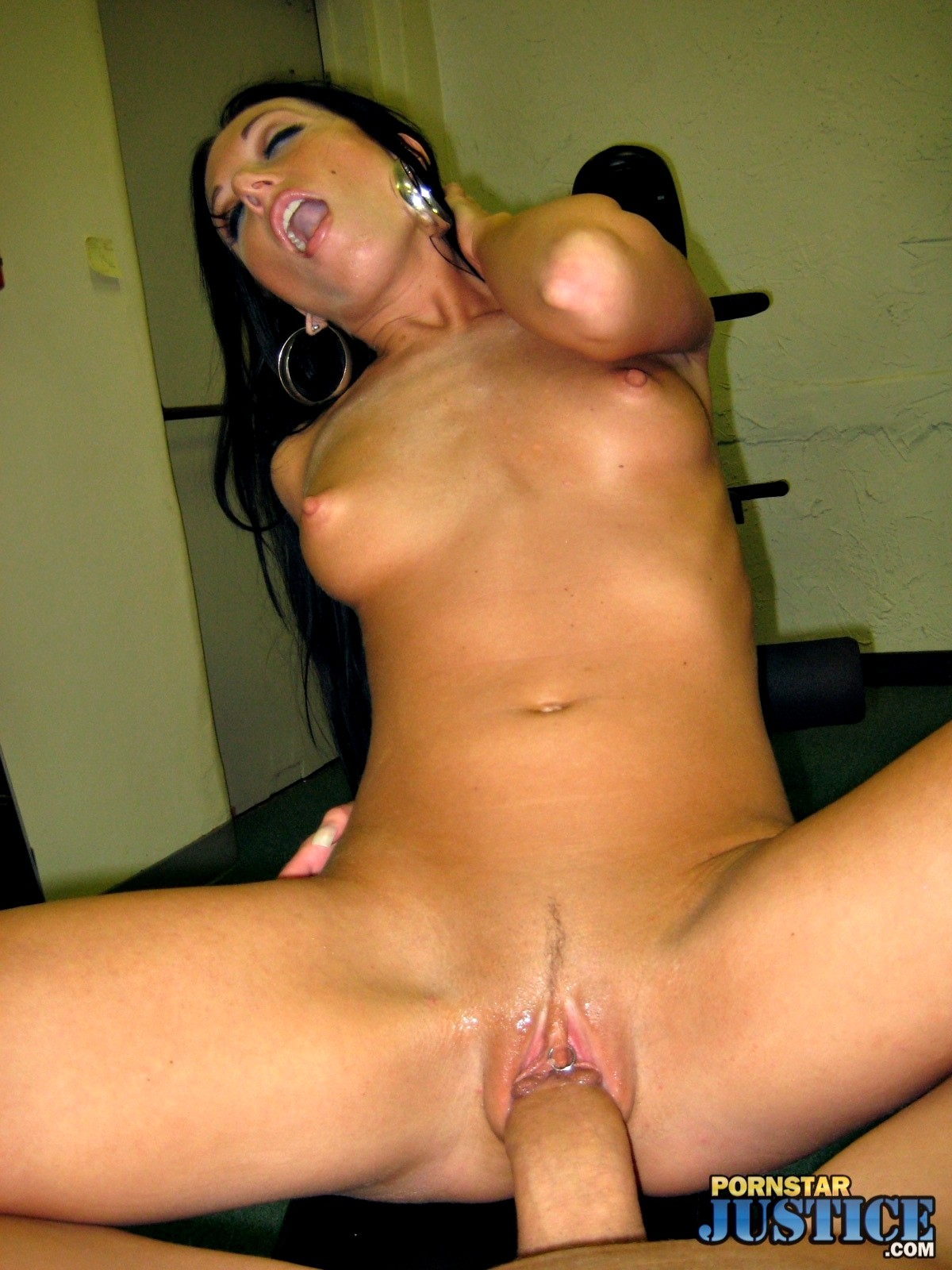 Mardi gras party girl spreads her pierced pussy wide open