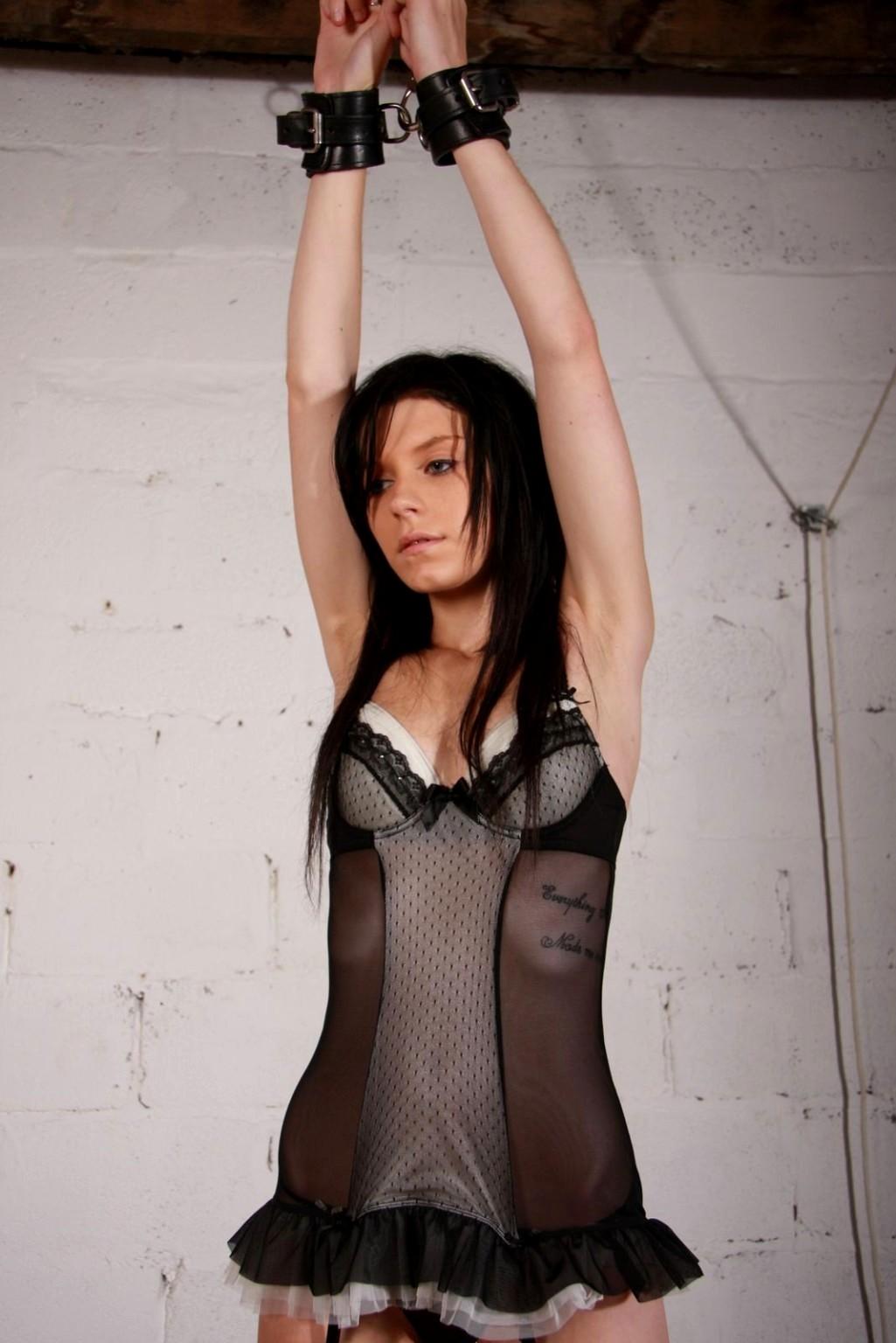Babe bound in steel restraints vibed